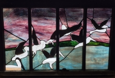 Pelicans, stained glass window